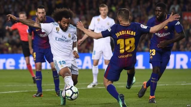 """مدرب شهير يدق """"طبول الحرب"""" بين ريال مدريد وبرشلونة"""