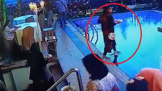 """""""دوخة الصيام"""" تلقي بشابة في مسبح أثناء بحثها عن مائدة للإفطار"""