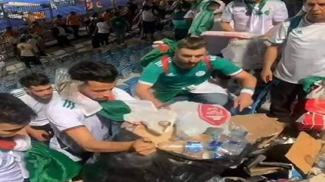 سلوك راقي..أنصار المنتخب الجزائري ينظفون المدرجات (+صور)